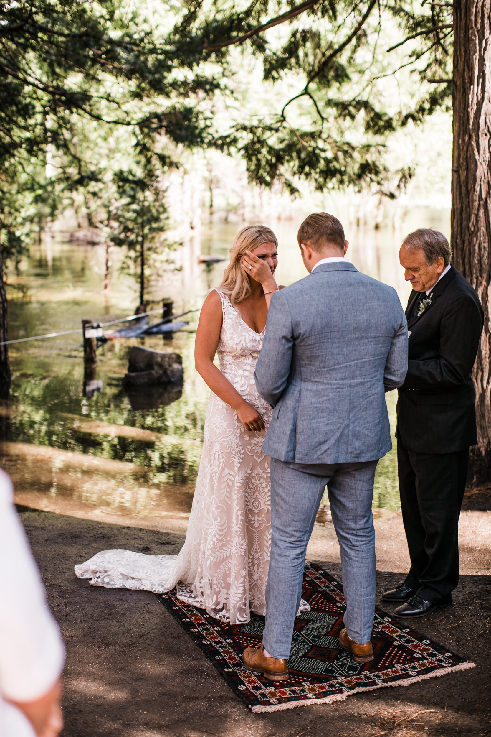 Erika + Grant's intimate Yosemite National Park destination wedding + romantic backyard reception under twinkle lights | ceremony in the woods in yosemite valley | the hearnes adventure photography
