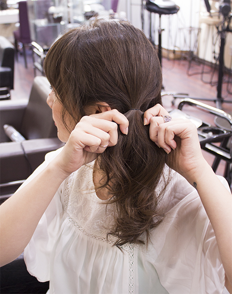2) Tie your hair into a pony tail behind your ear. Use small hair elastic to hold.