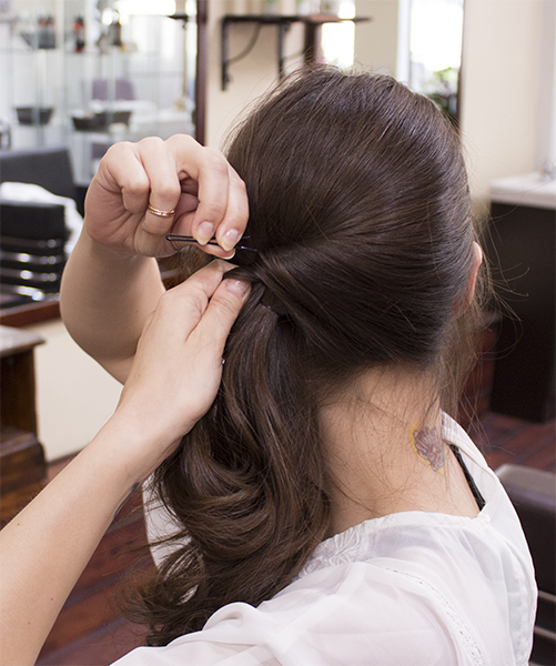 3) Gather hair on the right side, twist and pull upwards to the left side (above the knot). Keep in place with a hairpin.