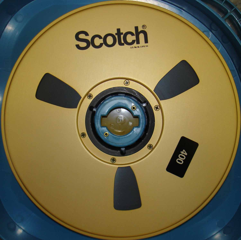 "A Reel of Scotch 3M 400 2"" Quad Videotape with the Foam Flange Inside of a Rigid Shipper."