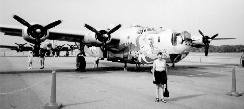 B-24J Liberator, Dragon and His Tail Kendra Jones Garrett, Lt. Maynard Jones' daughter Blaine-Anoka Airport, July 2002 B-17 sits behind the B-24J