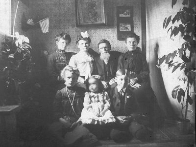 Probably about 1902, assume the Garrett family home in Macksburg Back Row, L-R:  Laura Garrett Iiams, Flora Garrett Barker, Charles Robert and Catherine Garrett Front row, L-R:  Lula Iiams, Nina Barker, Harley Garrett