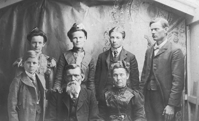 Winter 1902, location unknown Back row, L-R:  Laura Garrett Iiams; Flora Garrett Barker; Charlie Franklin; Wesley Green Garrett Front row, L-R:  Harley U. Garrett; Charles R. Garrett; Catherine McGuire Garrett
