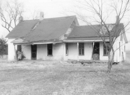 Abandoned farmstead of Jesse H Read, Anzo's father. Figure at left Kendra Jones Garrett, Anzo's great granddaughter, photo March 1980