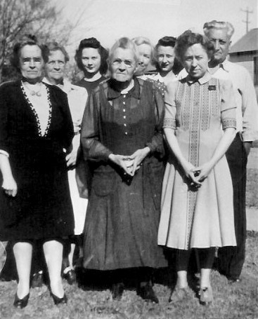 Back Row, L-R: Mertie Bushnell Rush; Donna Ranne; Bertha Bushnell Talbott; Betty Lou Barkus; Louis A Barkus Front Row, L-R: Edith Bushnell Barkus; Anzo Etta Read Bushnell; Ruth. Bushnell Photo ca. 1943 or 1944 (probably same date as next photo)