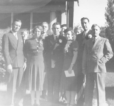 Left to right: Harley Garrett; Fried Kunz; Lorena Floye Garrett; Arnold Kunz; Kenneth Garrett, Nadine Garrett; Marian Garrett; June Kunz; George Kunz; Minster Thomas Foglesong Probably in front of the parsonage, 4 September 1939 Winterset, Iowa
