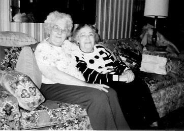 Goldie Livingston, left, and Marian Kreie Garrett Goldie's house in Winterset, Iowa, undated