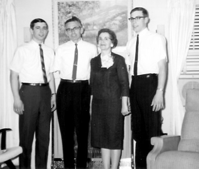 Left to right: Kenneth L; Kenneth Lester; Marian; Craig Garrett 219 S. Locust, Colfax, Iowa, probably May 1965