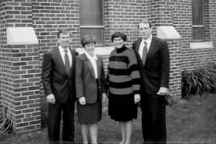 Sons and Wives: Left to right: Kenneth L. and Kathleen Buysse Garrett Kendra Jones Garrett and Craig Garrett