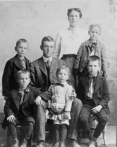 Front row, L-R: Keon Keith; Paul Elry; Eugene Agustus Middle row, L-R: Kenneth Clay; Thomas Andrew Jones; William Carl Back row: Eva Hyde Jones Twins Lewis Irwin and Harvey Darwin are not shown Undated photo, circa 1906, unknown location