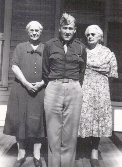Lt. Maynard Jones posing with his grandmothers L-R: Eva Hyde Jones; Clementine DeMoss Shutts Probably summer/fall 1943, Location unknown
