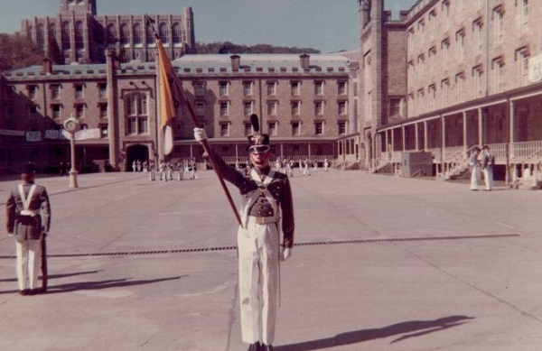 Craig Garrett as Guidon Bearer for Co. B-1, Oct 1967 Central Area with view of clock tower. Cadet Chapel seen above Central Area Barracks