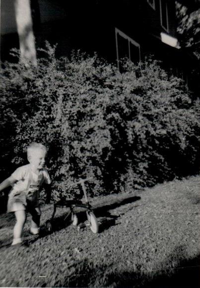 Craig with Kenny's trike? Lorimor, Iowa. Undated photo