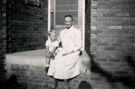 """My mother wrote, """"about 1949 with Grandma Wurster who was staying with her daughter Lillian Means. Her hometown was Lenox, Iowa. She & Craig had a mutual love affair."""" Note the lack of front steps."""