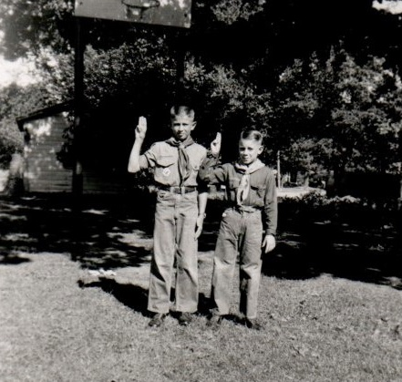 Kenny as Boy Scout with 3-finger salute about 1957 or 1958 Craig as Cub Scout with 2-finger salute At South Lincoln. Note basketball hoop in background