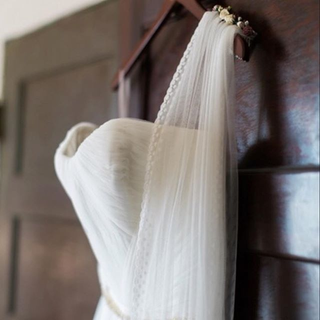 Bride Rocco's Classic Veil with custom spotted lace edge and parchment flower comb. Just hanging there, all ready for it's moment in the spotlight.  Photo by Taylor Kinzie Photography | www.taylorkinzie.com