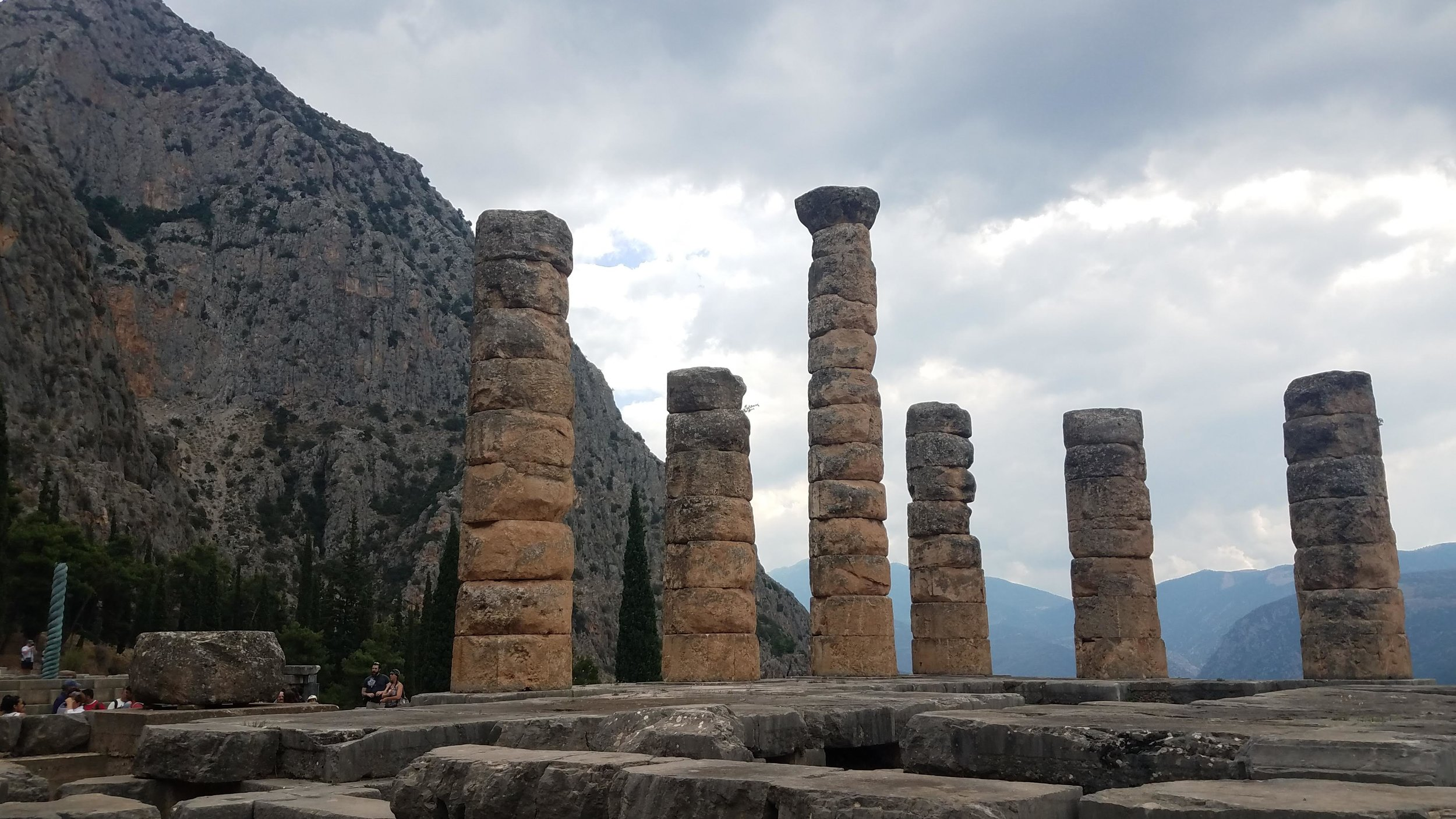 "Ruins of the Oracle at Delphi (or Temple of Apollo), where for centuries Greeks would pilgrimage to seek answers to their life problems… And a ""conduit to the gods"" who was under the influence of heavy incense would answer in nonsense terms, which were then translated into a mysterious and non-specific declaration by a team of priests, and which was then left to interpretation entirely by the recipient."