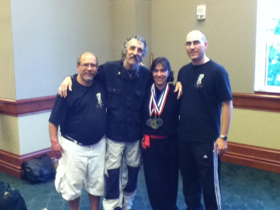 Three Senior Students & Teacher (midway through Internal competition)