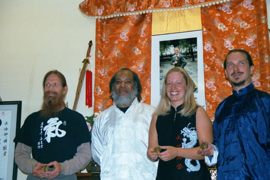 Red Morton, Warren Pretlow (their teacher), Wendy DeGraffenried, Michael DeMolina in their anchorage, alaska school, Spring 2002 at improvised medal ceremony in front of Jou Tsung Hwa altar.  Tested and awarded by laoMa at first long distant testing.
