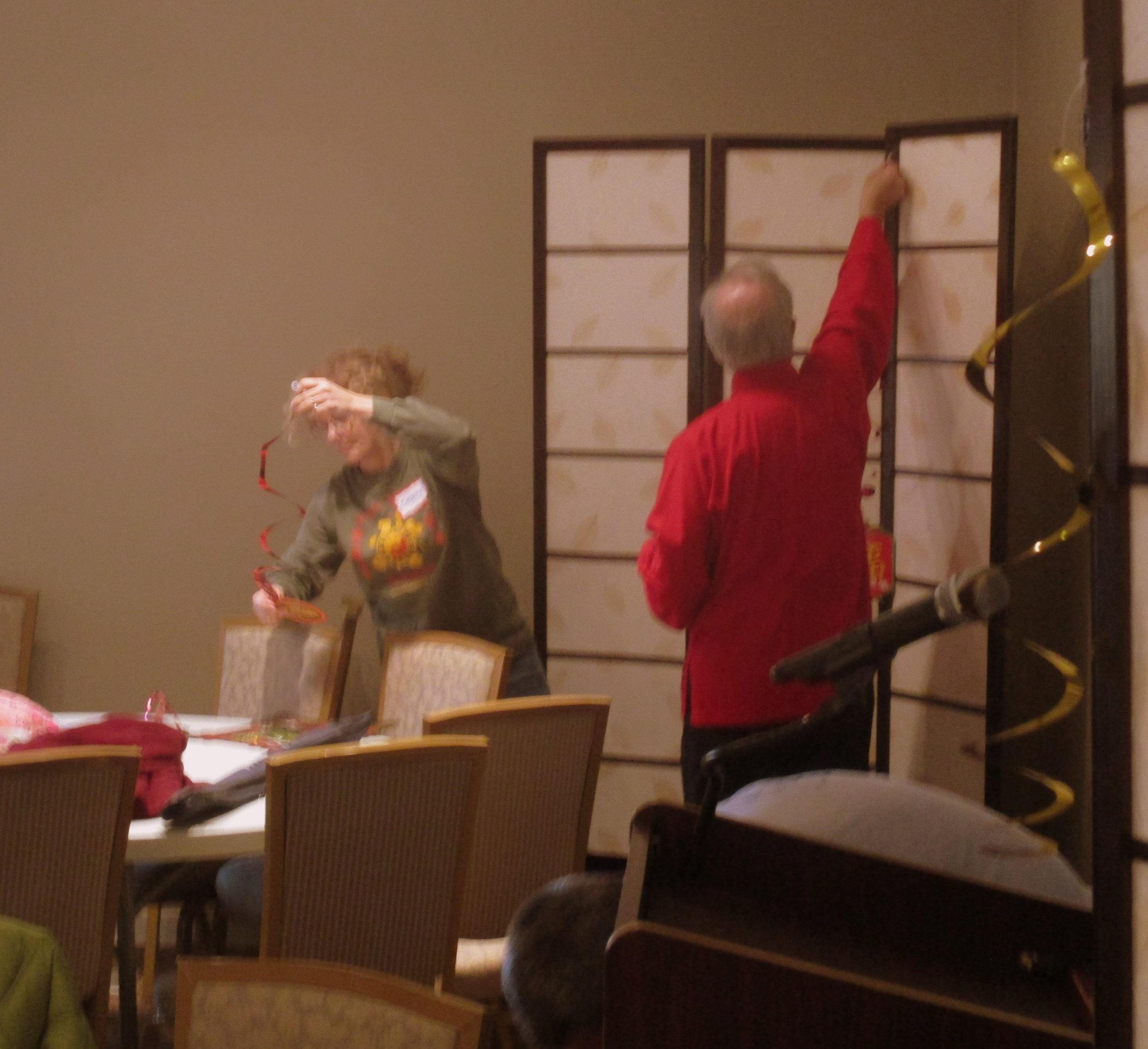 Helping Hands break down decorations