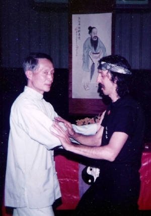 Tuishou with Jou Tsung Hwa, early 80's at his NJ school in front of Zhang Sanfeng altar.