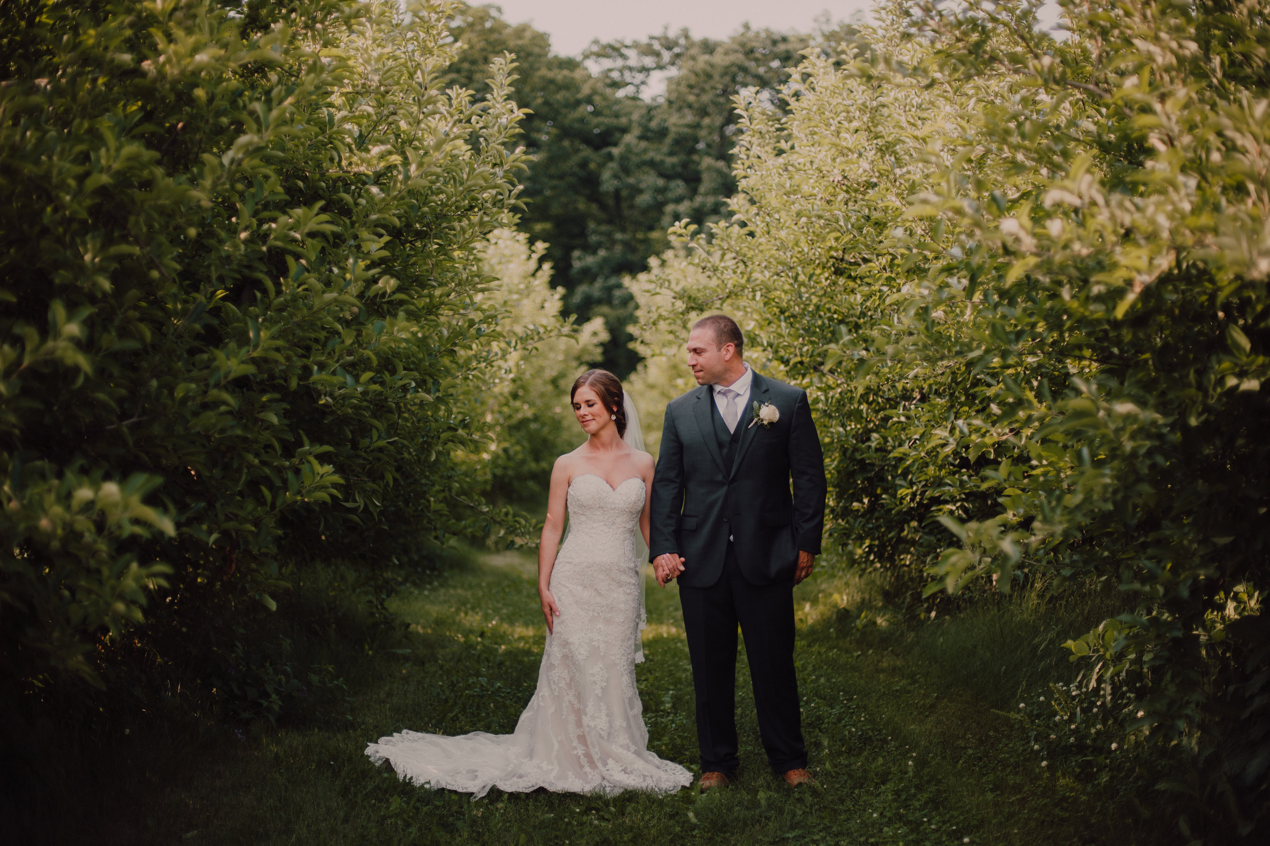 Apple Orchard Wedding - Church: Saint Gabriel ChurchVenue: County Line OrchardHair: Deanna Lewis MakeupMakeup: Tranquility SalonFlowers: Chalet FloristDress: Stella York from Martellen's Dress and Bridal BoutiqueENGAGEMENT SHOOT