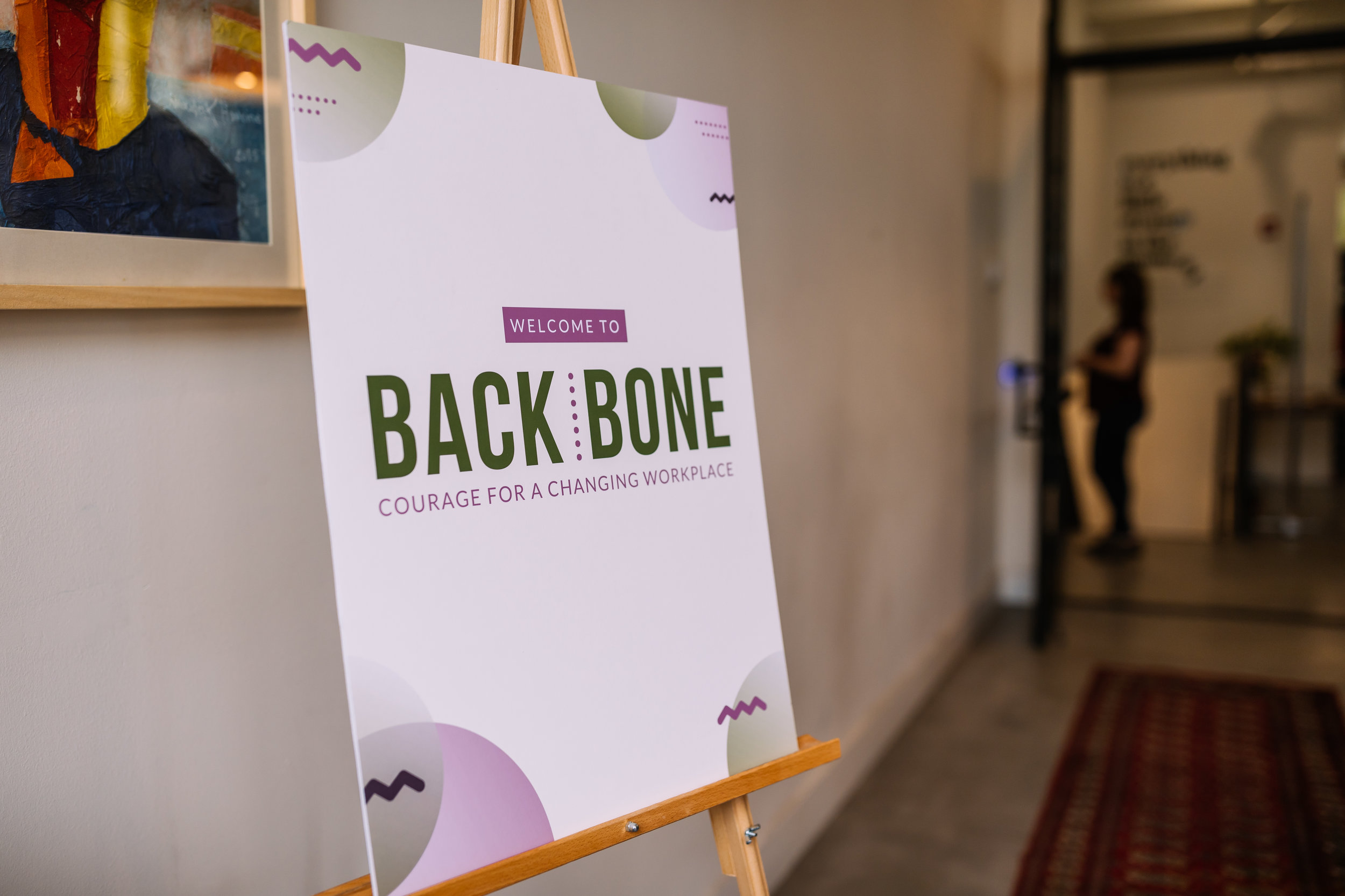 For Backbone: Courage for a Changing Workplace, we created consistency by using the visual identity and brand colors across all materials.