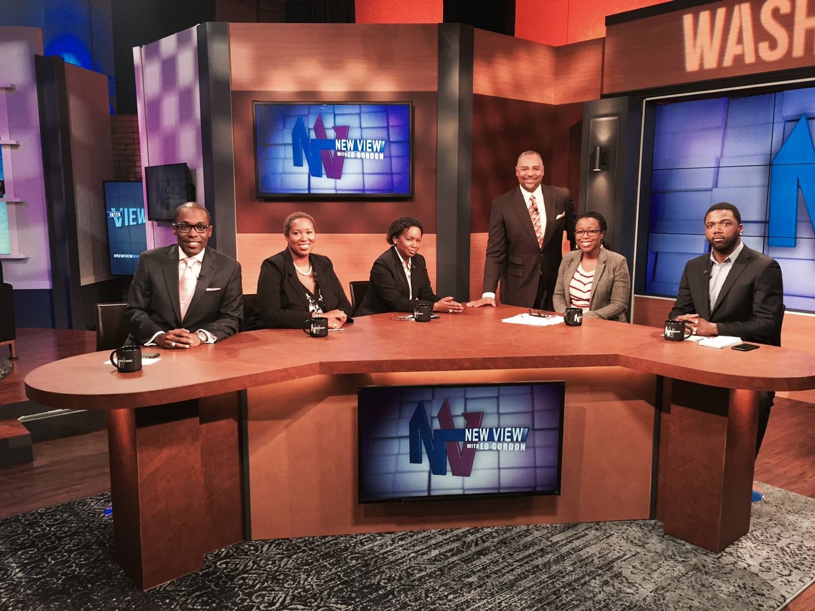 On set w/ panel and anchor Ed Gordon