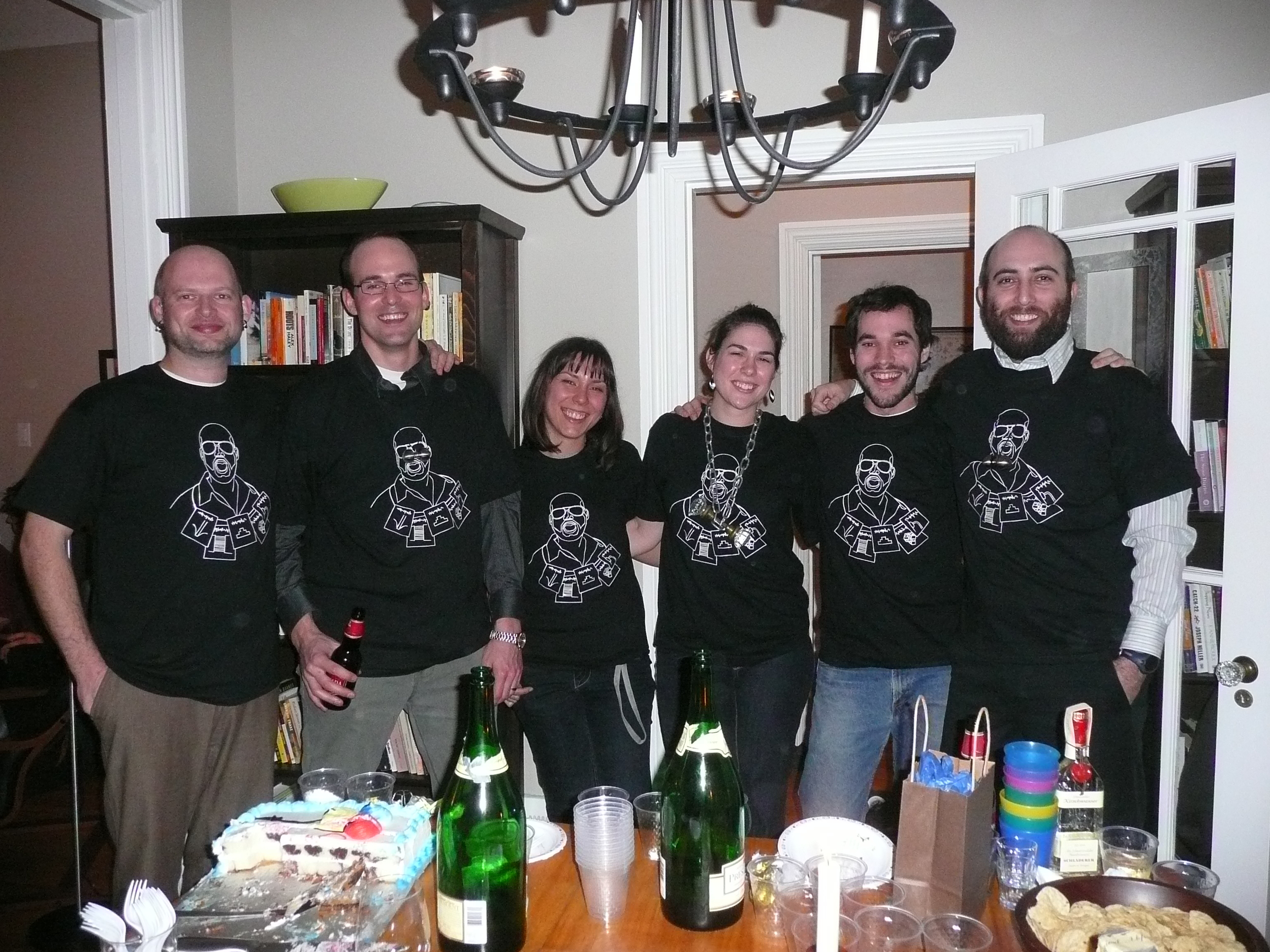 The Group at the PhD defence party wearing T-shirts displaying Kari's shame.