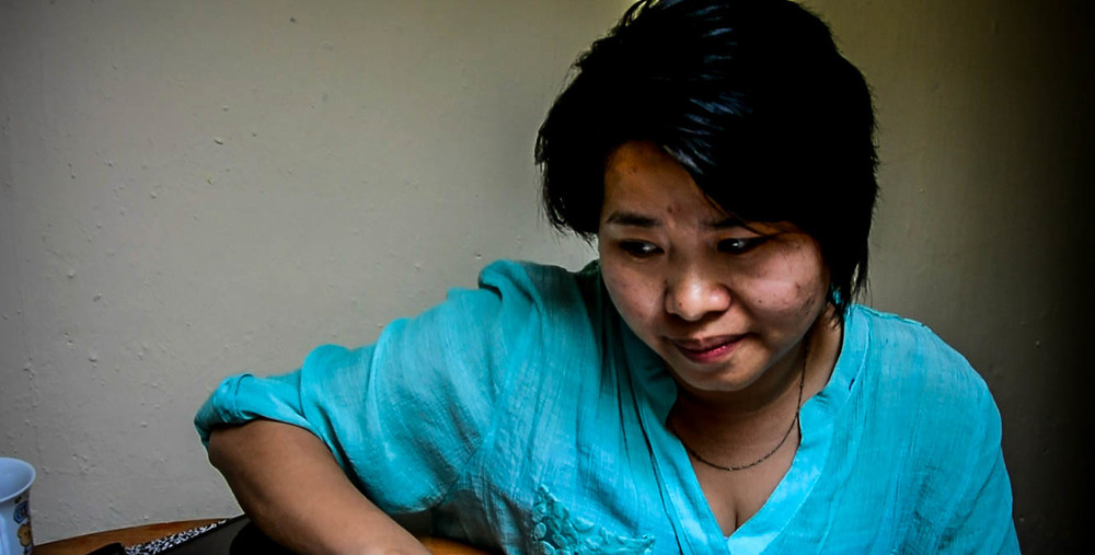 Woman telling her story (Nhung in her apartment, Hanoi)