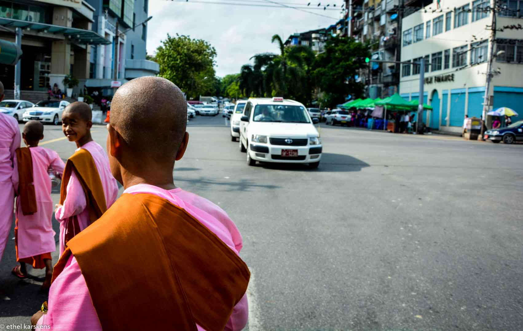 Girls running the alms in Yangon