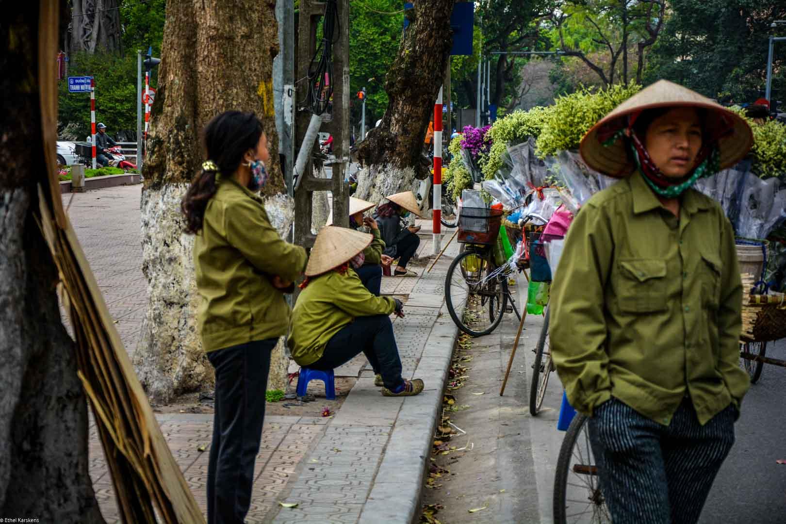 Women selling flowers in the street of Hanoi
