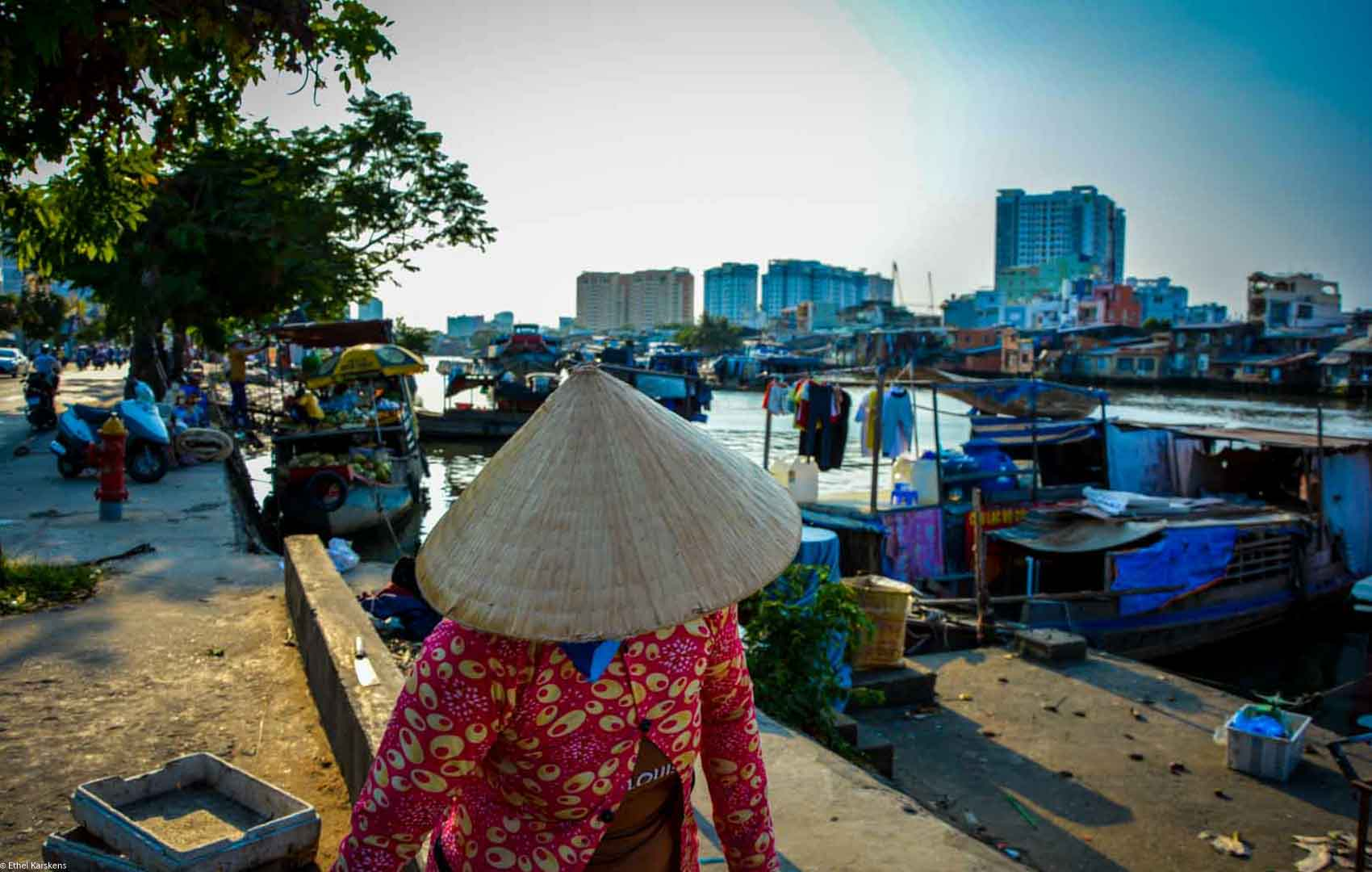 Woman walking near Kenh Te, Saigon