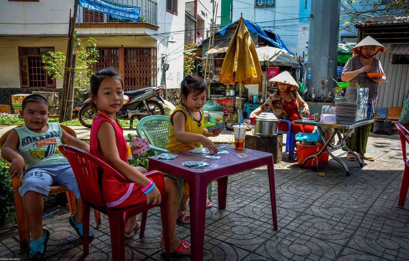 Girl playing cards (District eight, Saigon)