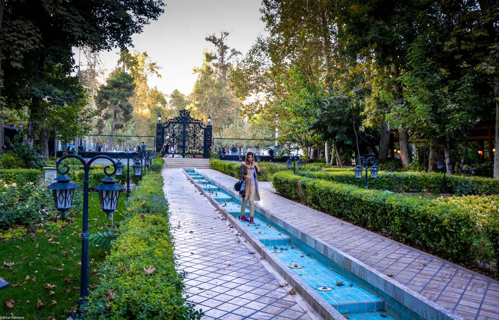 Girl walking in  Bagh Ferdows park