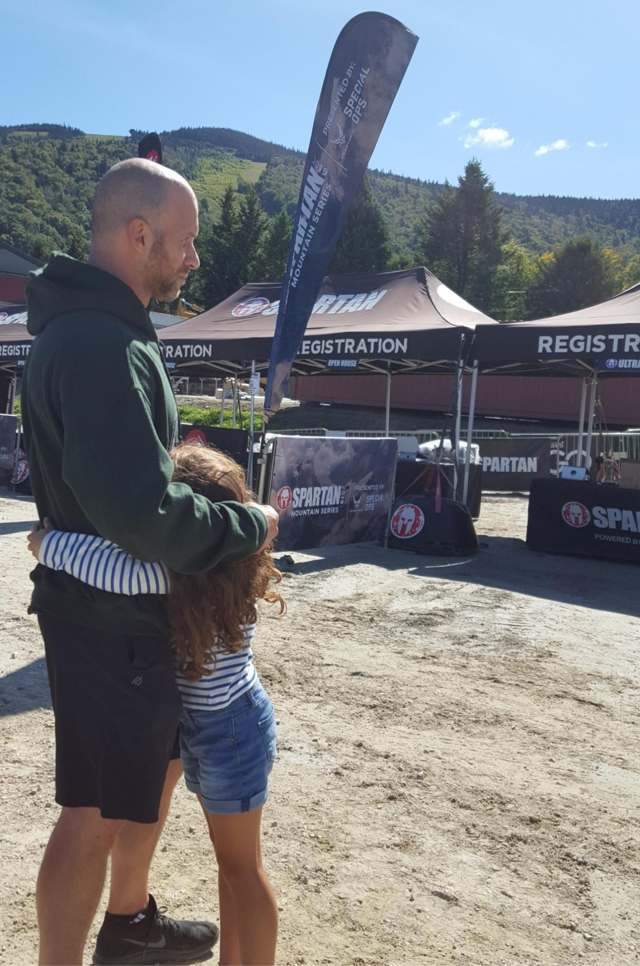 """Me and my #1 at the registration tents the day before the race. She's hugging me, wishing me luck and telling me """"Be safe, Daddy"""". (Photo Credit: My Wife)"""