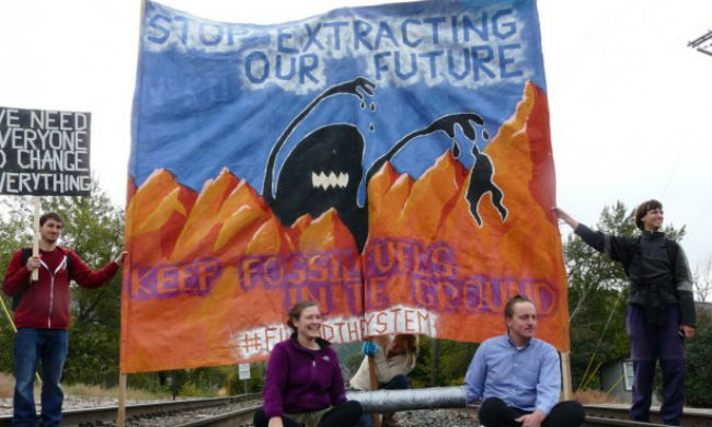 Activists in Montana locked down to railroad tracks, blocking a coal train in attempt to communicate the urgency of the need to transition away from the burning of fossil fuels
