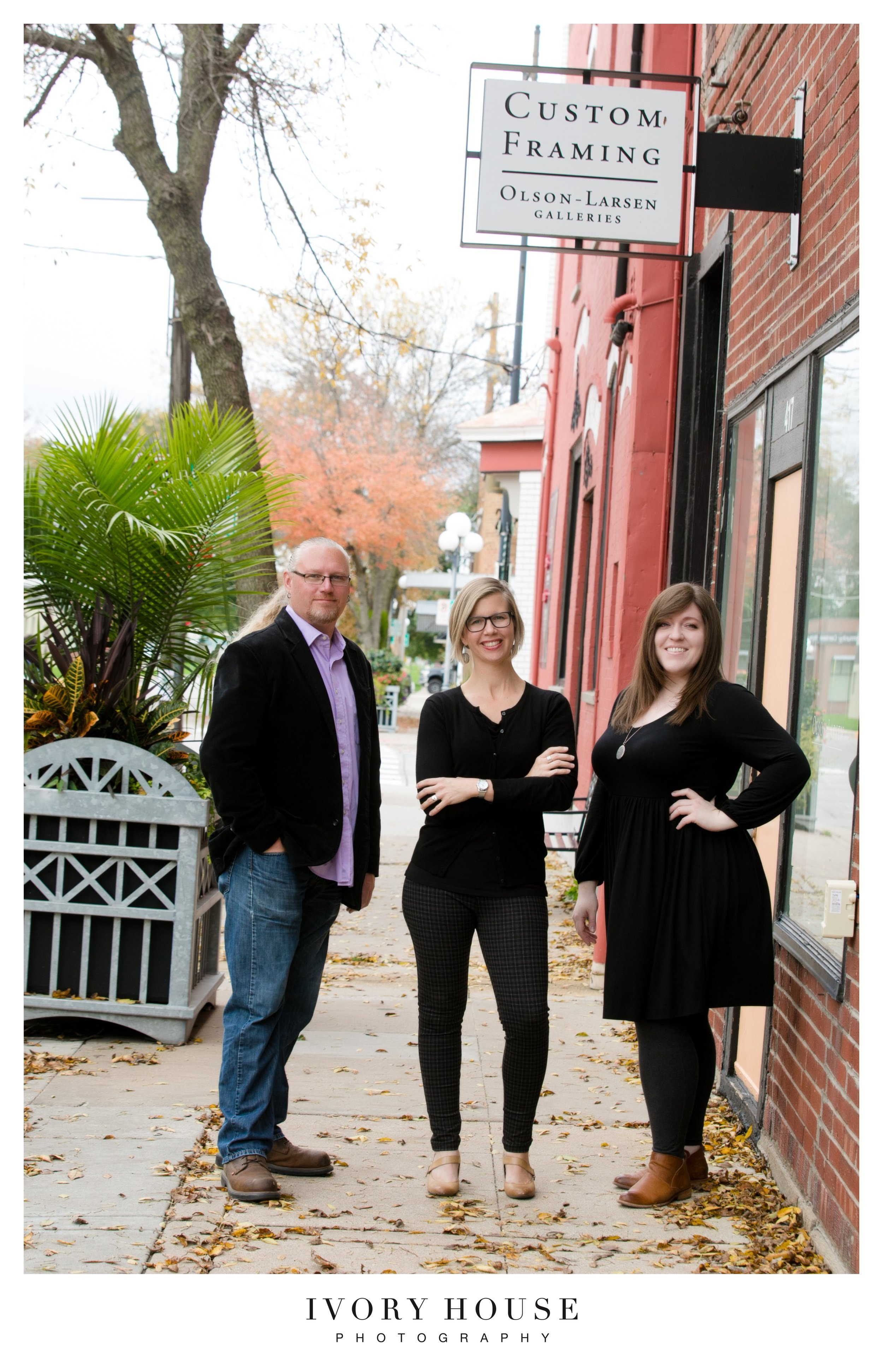 "The ""small but mighty"" team from left to right:  Mark Goodrich , Frame Shop Manager,  Susan Watts , Owner,  Alyss Vernon , Gallery Manager."