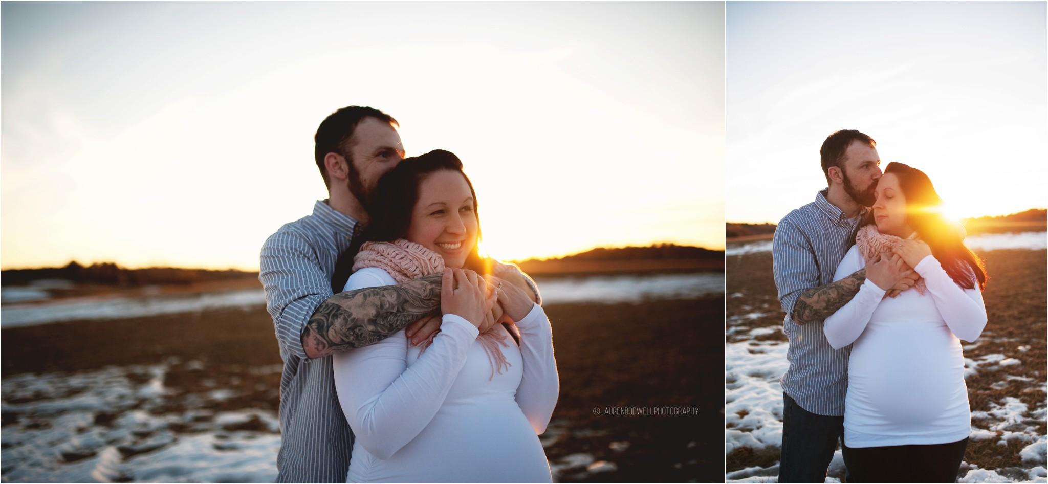 man and women hugging at sunset
