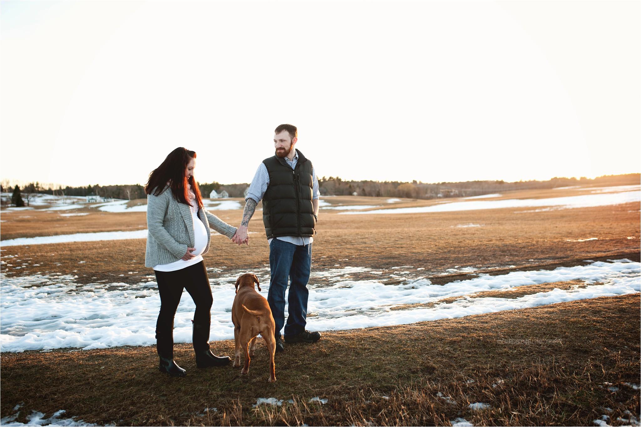 man and women walking their dog