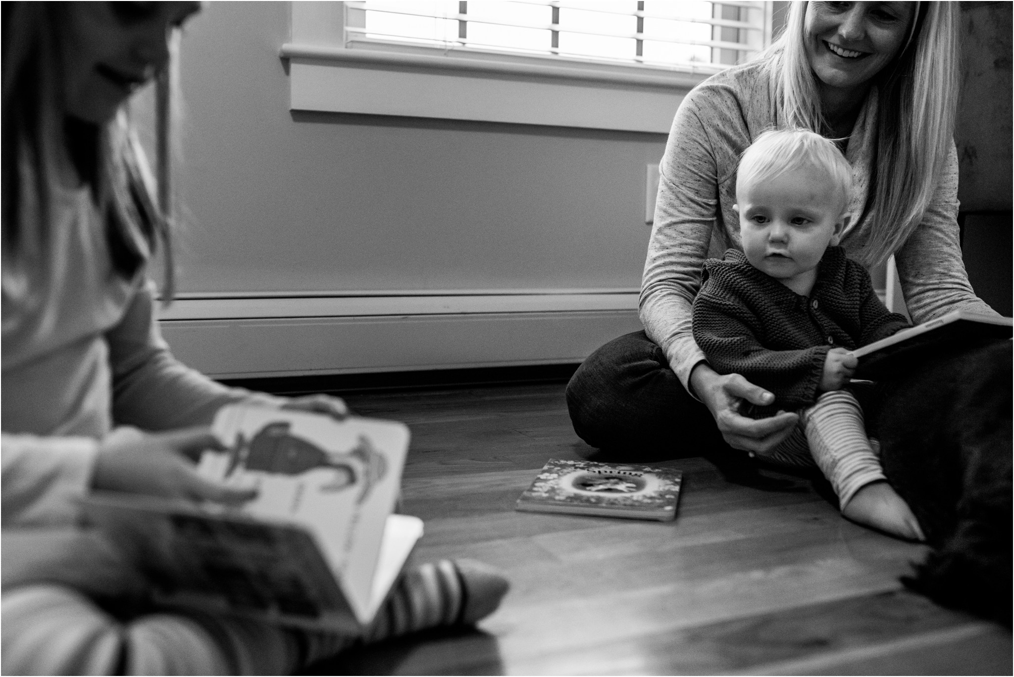 little boy looking at girl reading