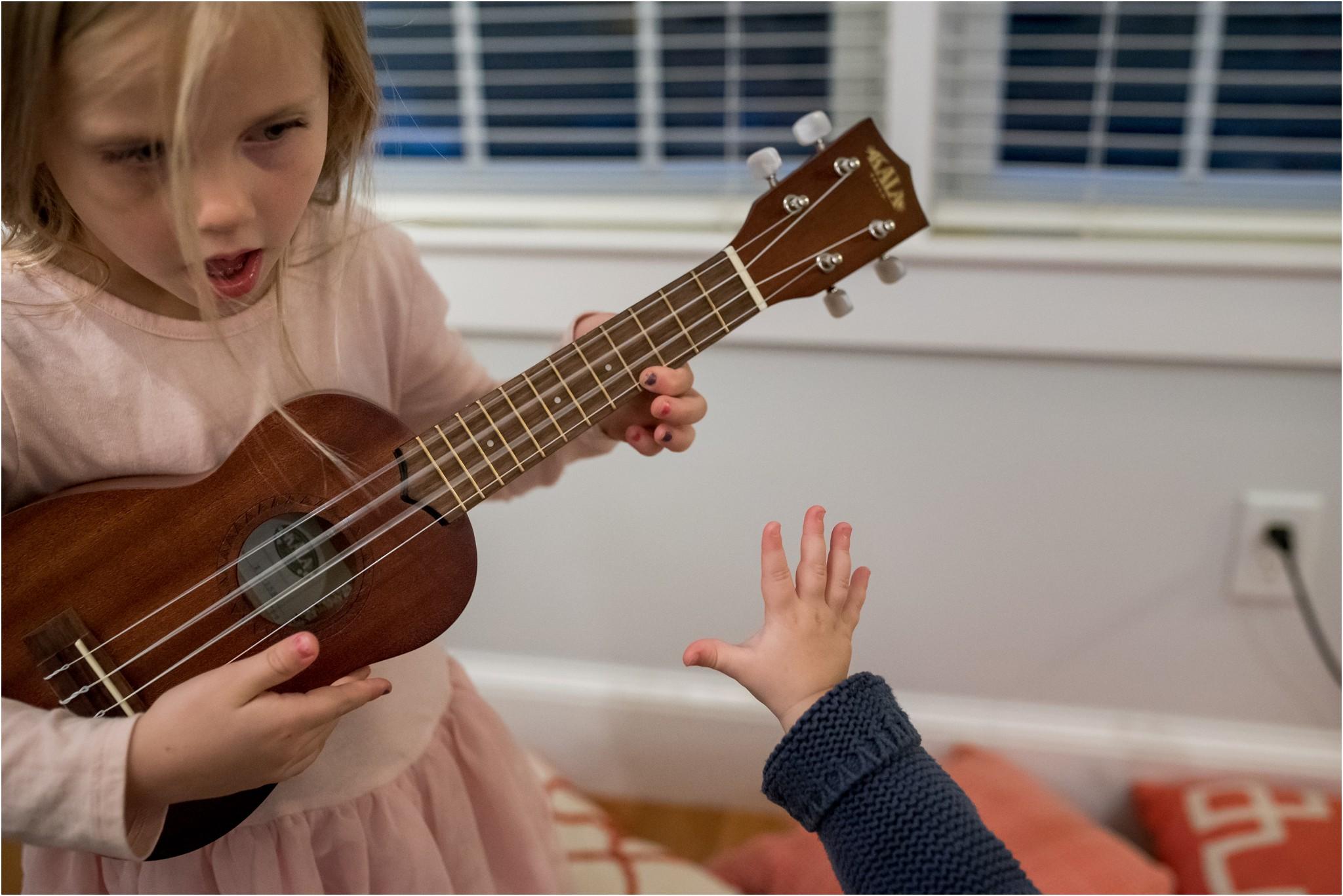 little girl playing the ukelele