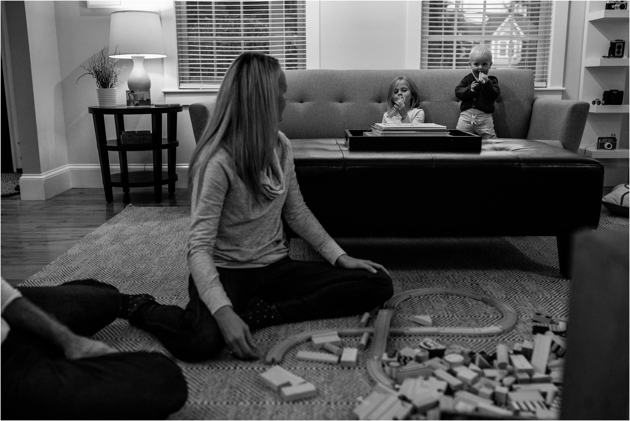 family playing blocks on the ground