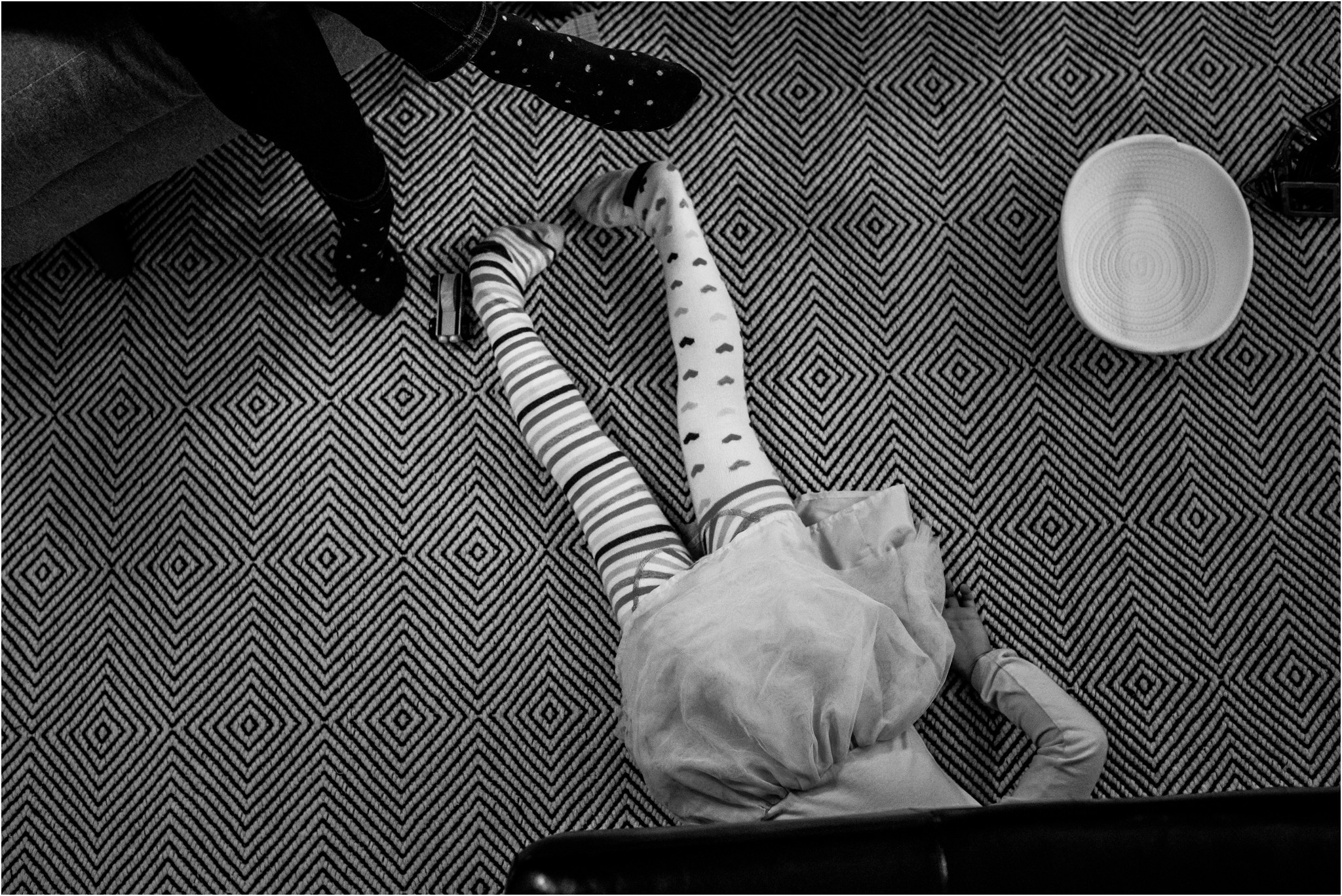 little girl laying on the ground