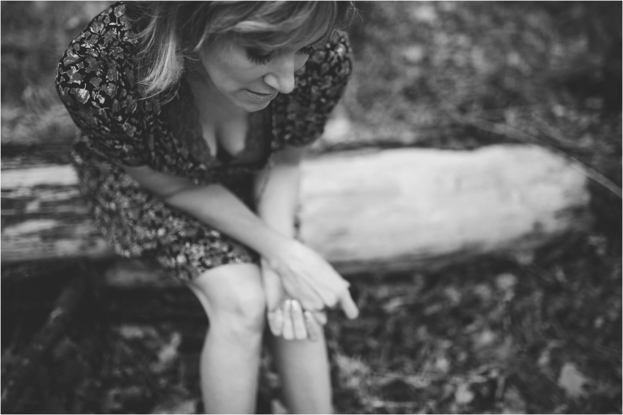 women sitting on a log