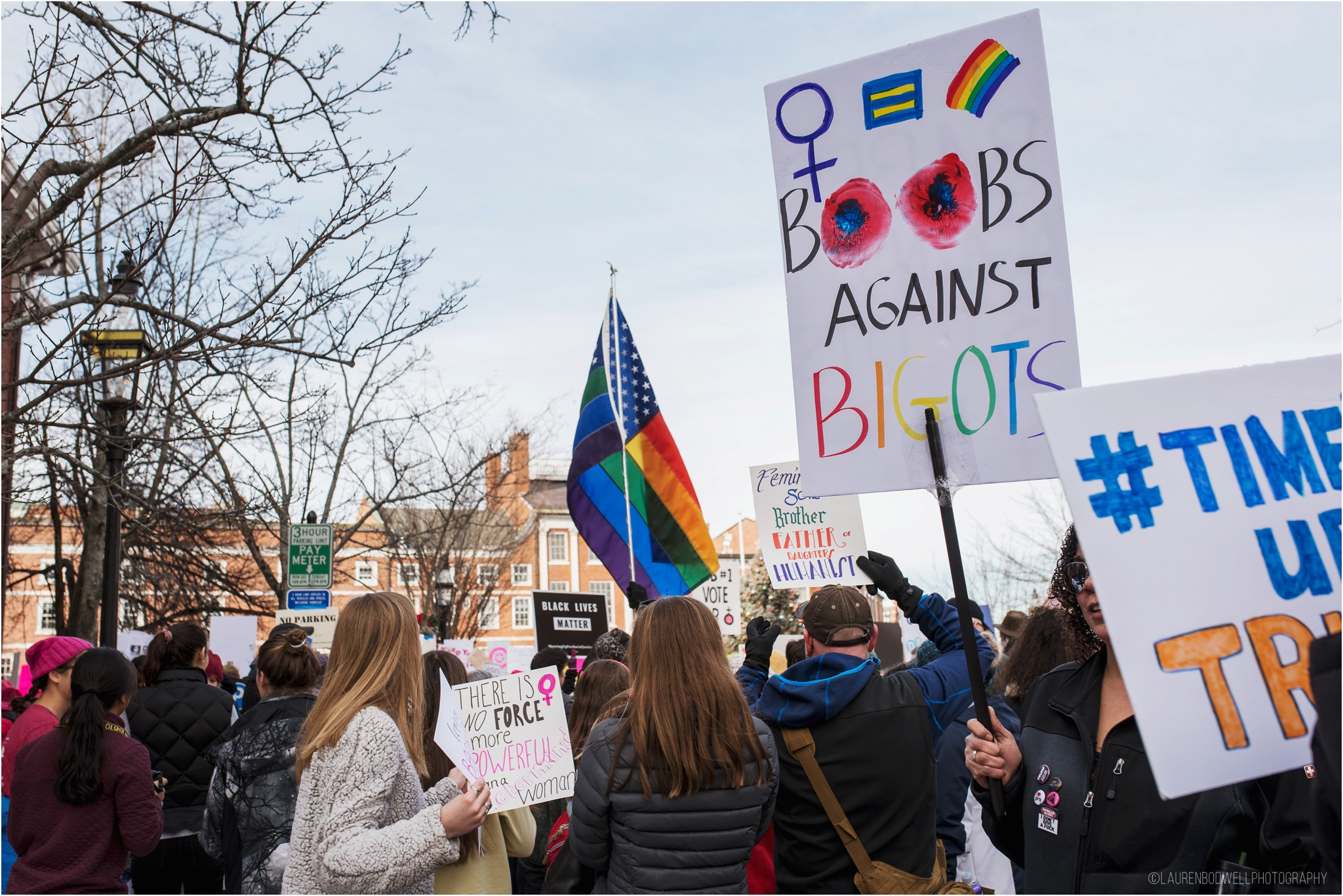 people holding up signs at women's march