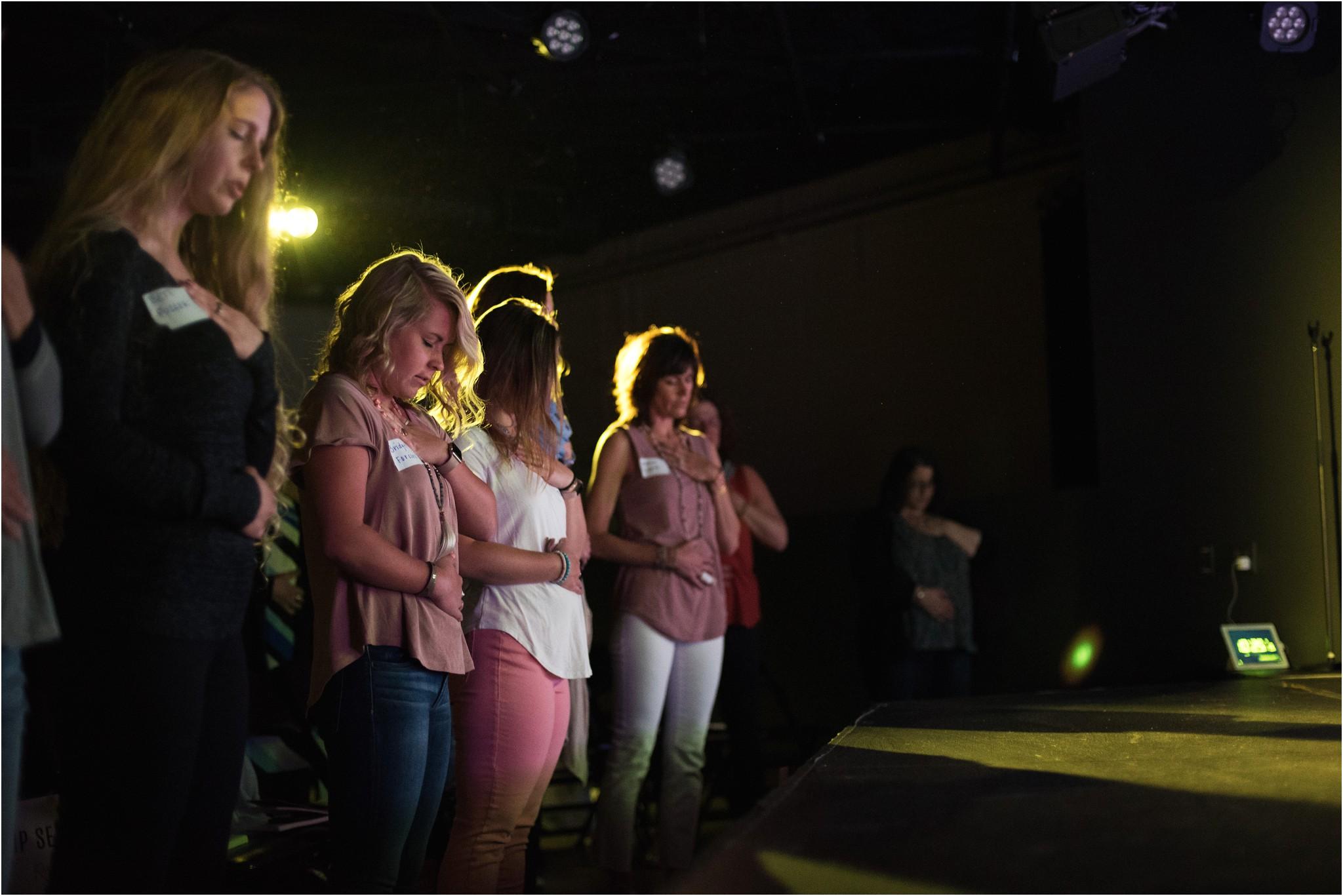 women listening to a speaker