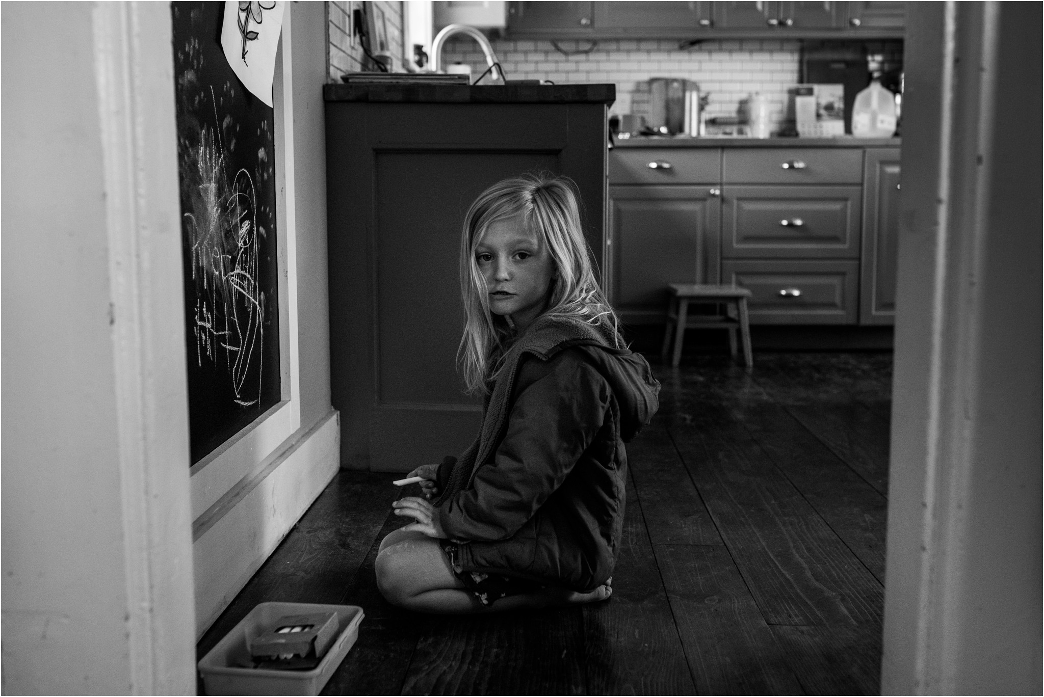 Girl kneeling on the kitchen floor