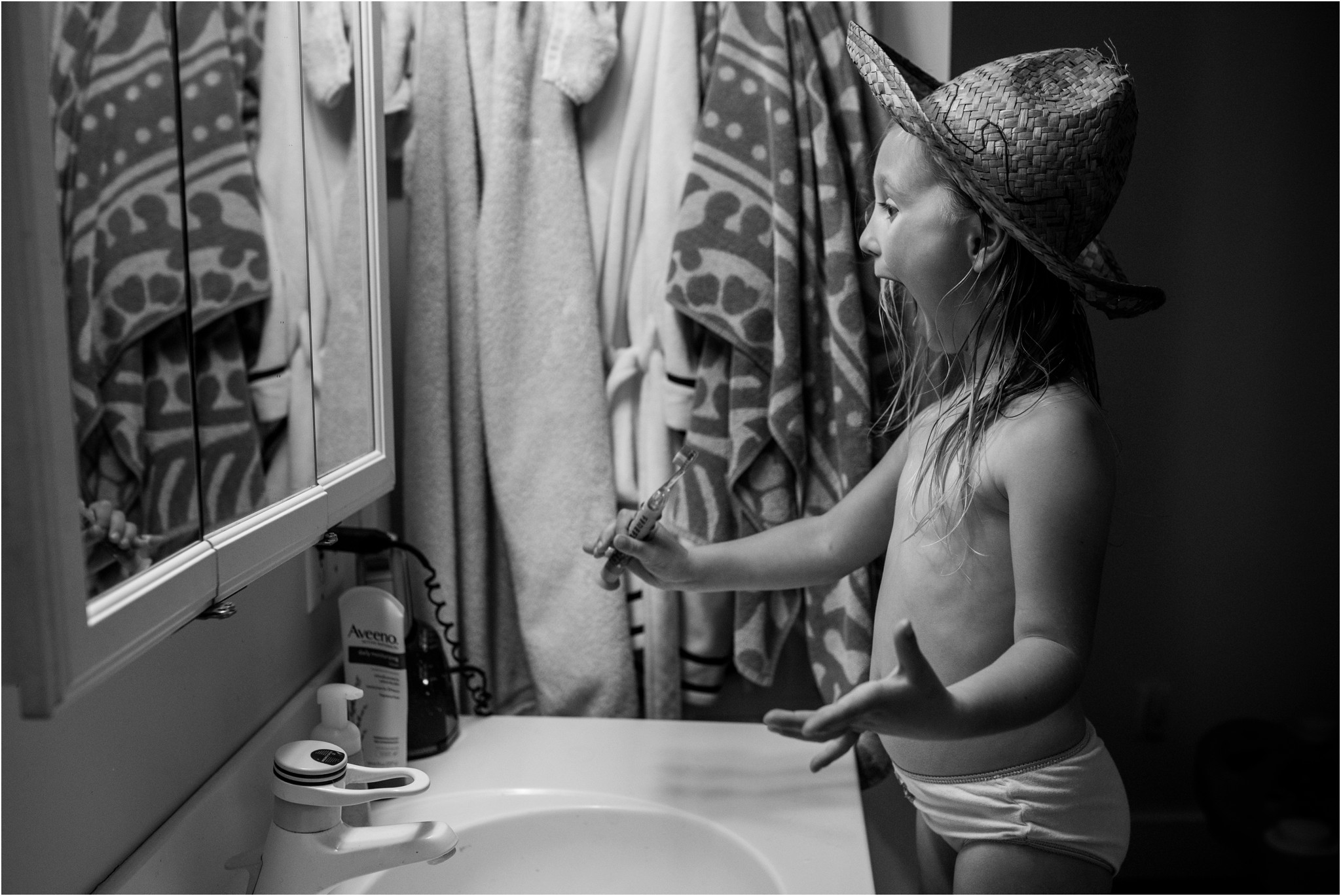 Girl wearing a hat while brushing her teeth