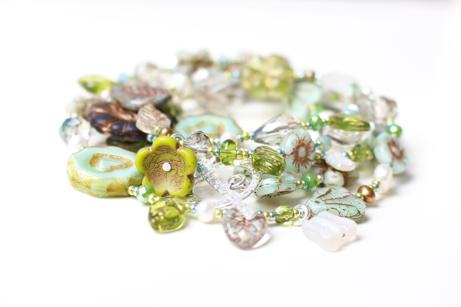 Long necklace in mixed green glass - designed by Nina Parker